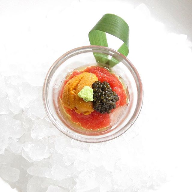 Sushi bar Omakase brings our chefs' creativity to the forefront...like this Toro chopped with tomato purée, uni, caviar and wasabi created by Chef Ryo Hasegawa at #NobuNY. Mix and eat with a spoon for the perfect combination of flavors - no chopsticks required! #nobustyle #omakase #sushi #uni #caviar #nyc