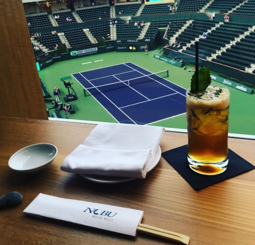 View from the top: Spectators may relax with a specialty cocktail, like the Nobu Pimm's Cup.