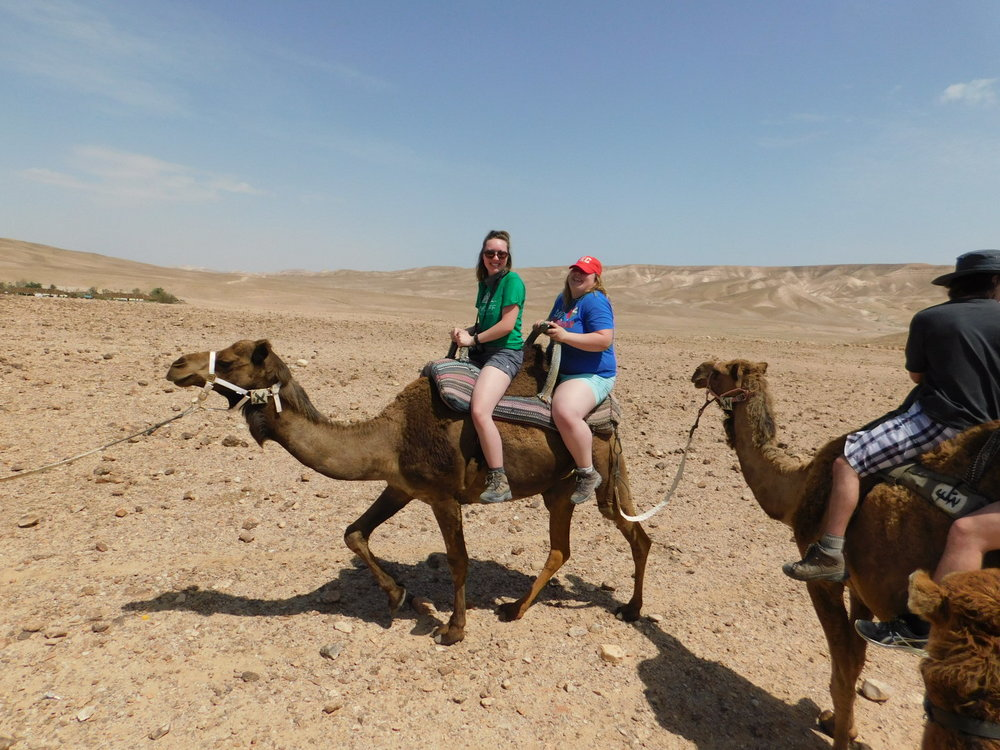 Emily and Henry riding their camel.