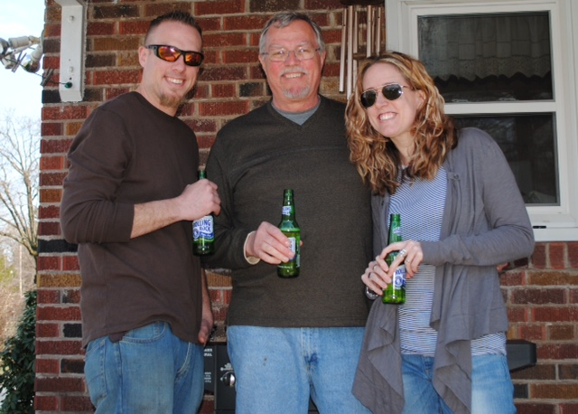 My brother, dad and me sharing adult beverages on the front porch