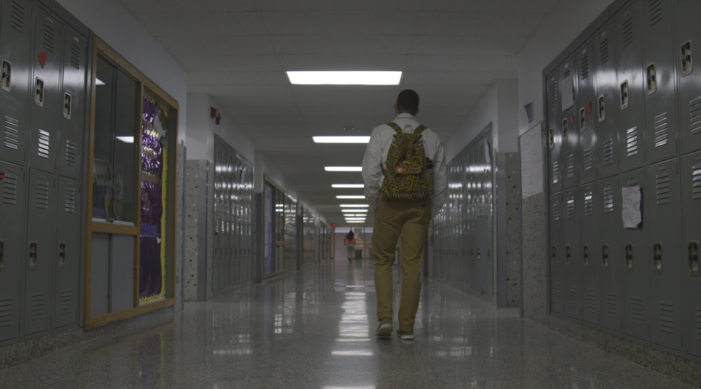 Jack walks through the halls of his high school; Christian Brothers' Academy