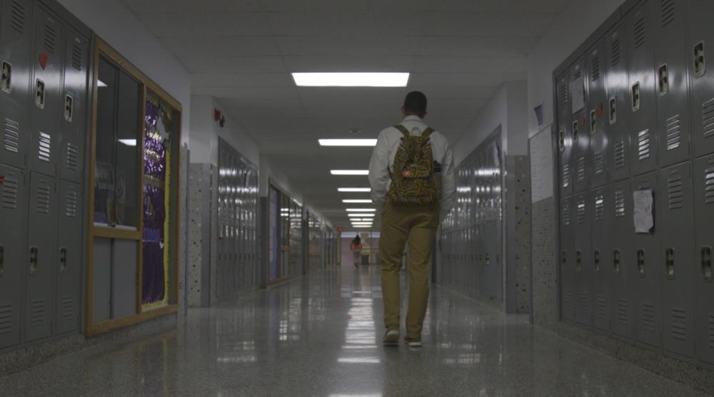 Jack walks through the halls of his high school; Christian Brothers' Academy