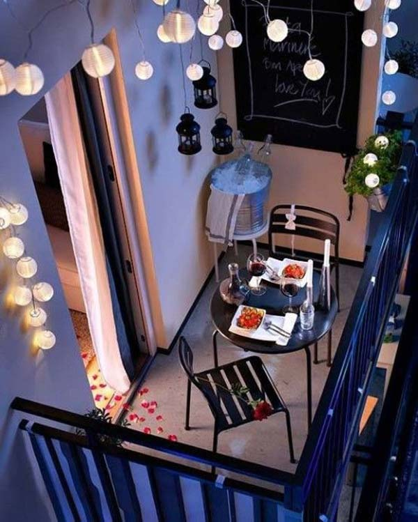 How romantic is this balcony! Dress up your small space with some small hanging lanterns and plants to decorate your railing. Simple outdoor furniture is perfect for this space when the colors of love are in the air (*cue the rose petal trail*) and candles are flickering against the burgundy colors of your wine.