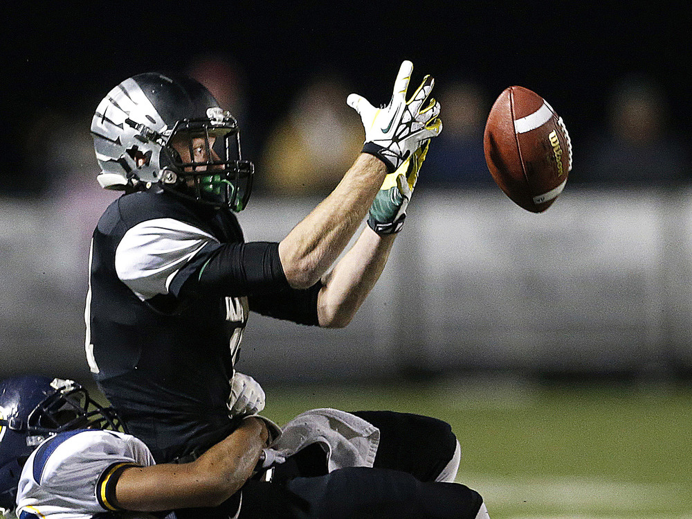 Westerville Central senior receiver Lucas Irwin is unable to receive a pass from senior quarterback Nate Jackowski in the second quarter, at Westerville Central High School against Solon High School, Saturday, November 8, 2014.