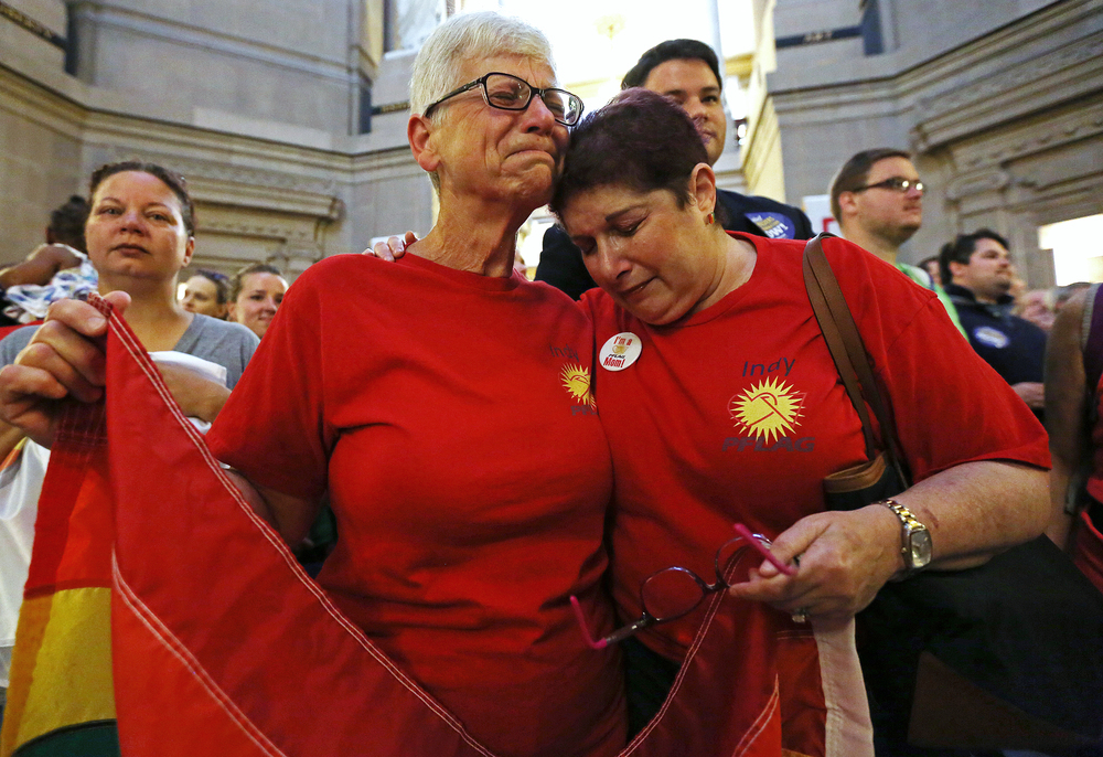 From left, Betty Lynch and Annette Gross react emotionally during a rally celebrating the nationwide legality of same-sex marriage, at the Indiana Statehouse, Friday, June 26, 2015, Indianapolis, Ind. Lynch and Gross both have gay sons who will now be able to marry in any state. Lynch is treasurer for the Indianapolis chapter of Parents, Families and Friends of Lesbians and Gays (PFLAG), and Gross serves as vice president.