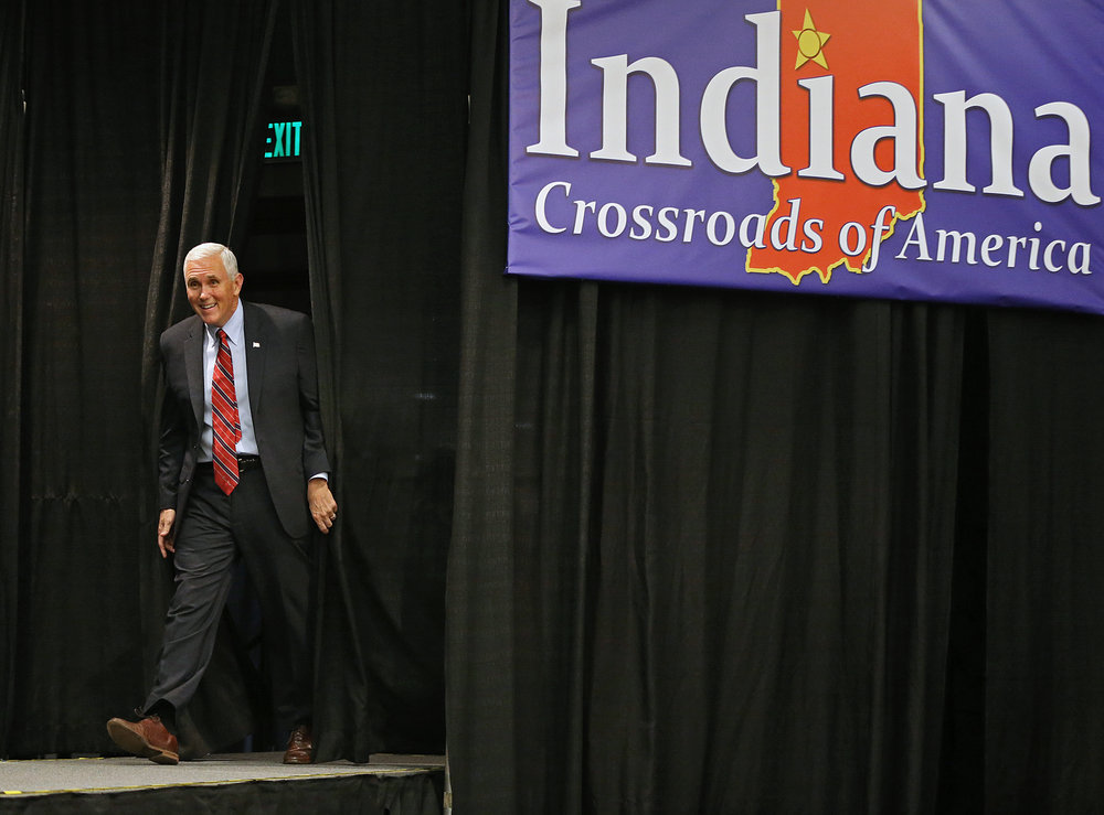 Indiana Gov. Mike Pence, with a new attitude as the recently-named Republican nominee for vice president, returns home to greet the crowd at the Allen County War Memorial Coliseum, Fort Wayne, Ind., Friday, September 30, 2016.