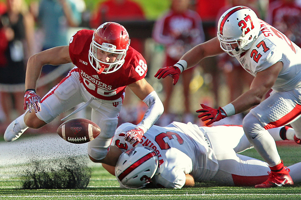 A pass to Indiana Hoosiers wide receiver Luke Timian (82) is incomplete due to defense from Ball State Cardinals linebacker Sean Wiggins (3) and Ball State Cardinals linebacker Stu Stanley (27) during third quarter action at Indiana University's Memorial Stadium, Bloomington, Ind., Saturday, September 10, 2016.