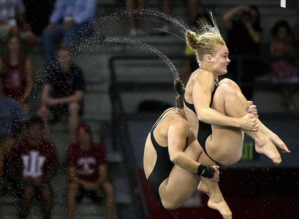 Front to back, Delaney Schnell and Samantha Bromberg dive during the U.S. Olympic women's synchronized 10-meter platform finals at IUPUI, Indianapolis, Wednesday, June 22, 2016.