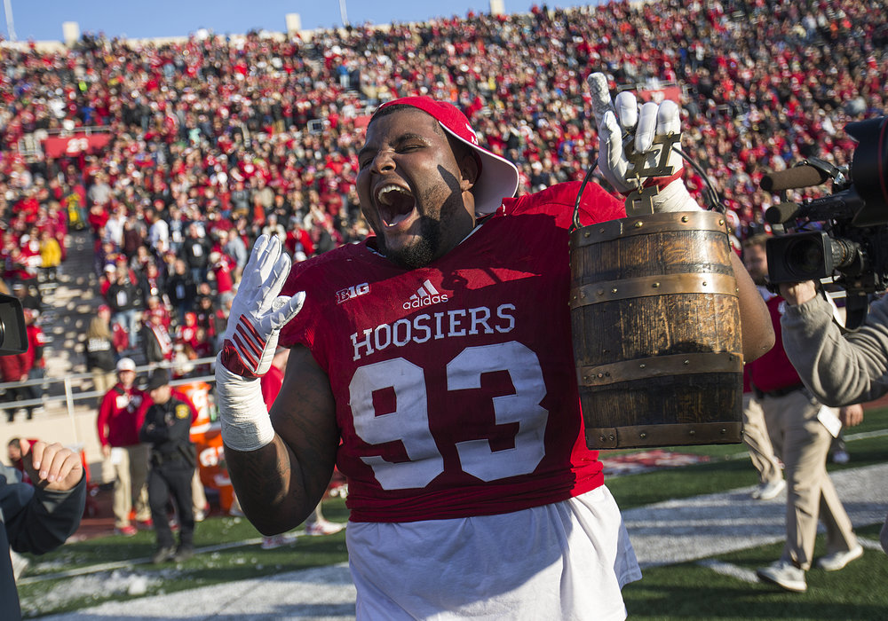 Indiana Hoosiers defensive lineman Ralph Green III (93) celebrates the Hoosiers' fourth consecutive Oaken Bucket win against the Purdue Boilermakers at Memorial Stadium, Bloomington, Ind., Saturday, Nov. 26, 2016.