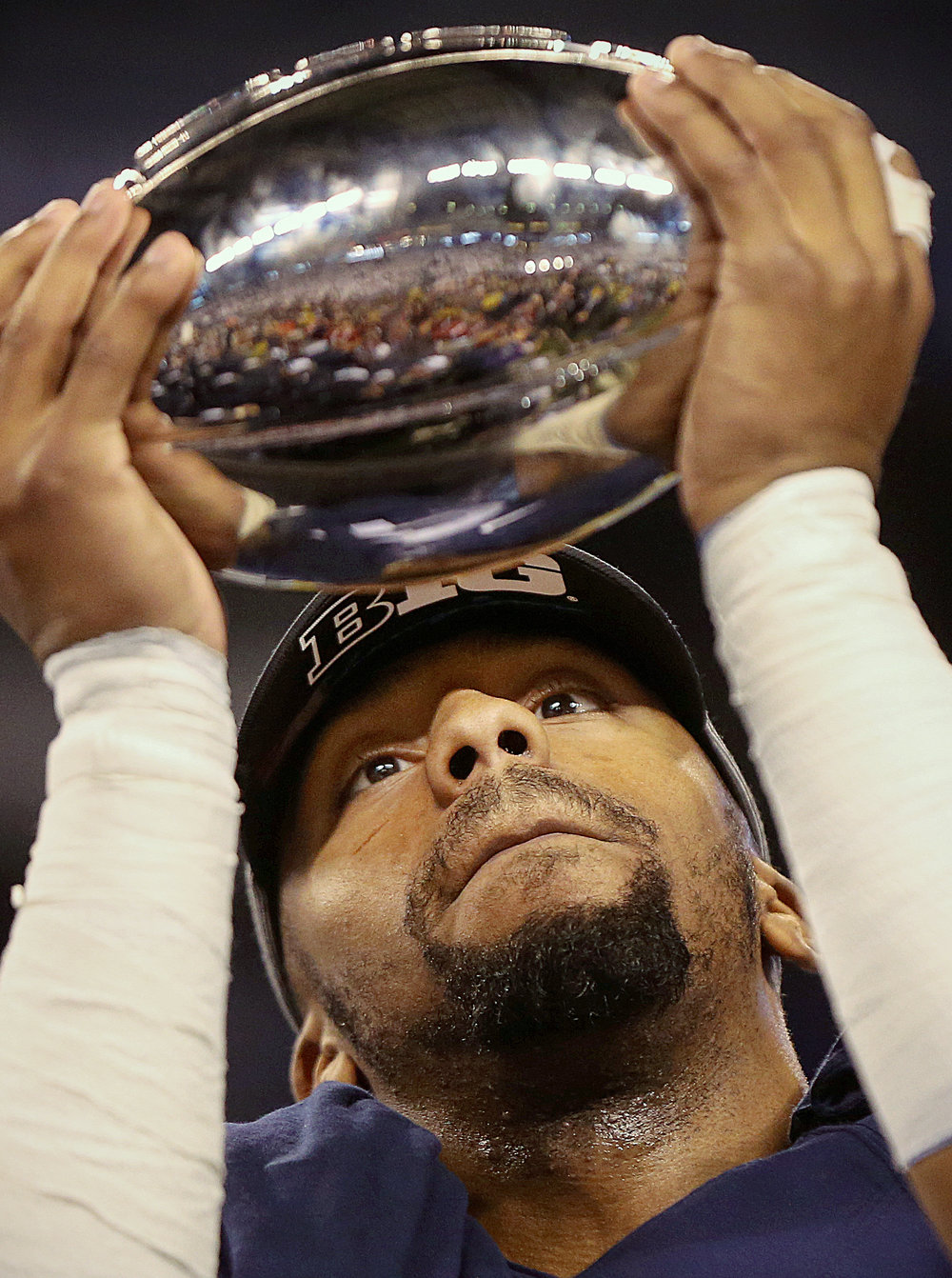 Penn State Nittany Lions cornerback Jordan Smith (12) checks out the Stagg championship trophy after winning the Big Ten championship against the Wisconsin Badgers, at Lucas Oil Stadium, Indianapolis, Saturday, Oct. 3, 2016.