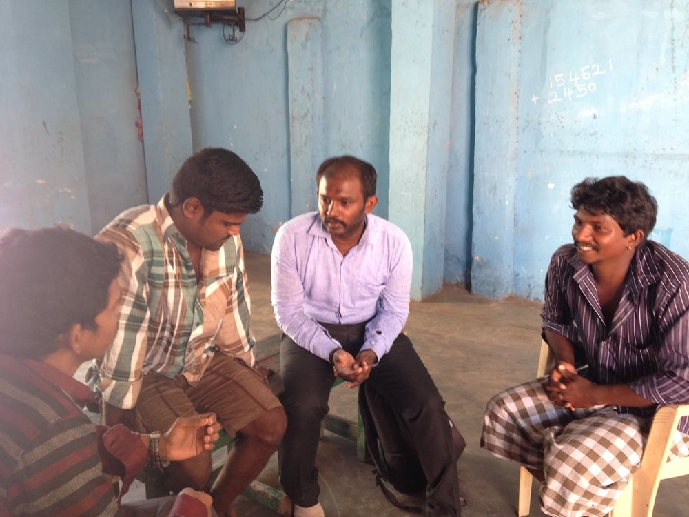 Uday conducts a focus group with the husbands of pregnant women in Kasimedu, Chennai.