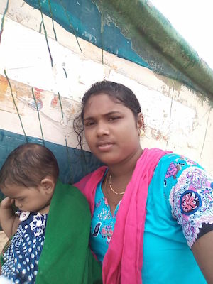Gayathri and one her kids in front of her home                              in Chennai.