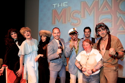 Tom Lenk as Zooey Deschanel, Jack Plotnick as Evie Harris, Nadya Ginsburg as Cher, Dennis Hensley as emcee, Tony Tripoli as Charles Nelson Reilly, John Carrozza as Greg Evigan, Maile Flanagan as Danny Bonaduce and Felix Pire as Ricardo Montalban