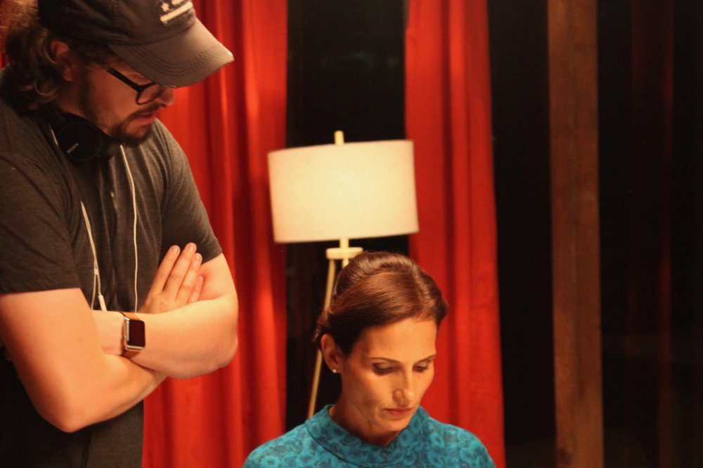 Christiano Dias and Lisa Roumain on the set of the Cold War dark comedy, HURRICANE, 2016.