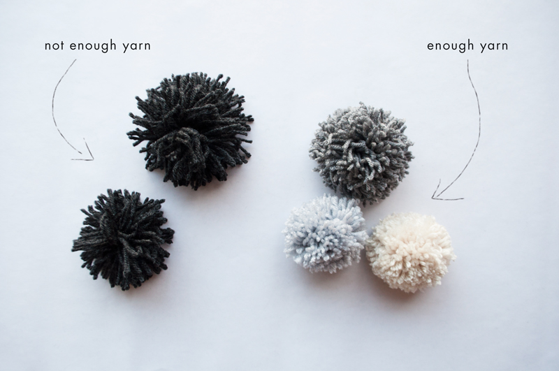 The more yarn, the better! We want these pom poms as fluffy as a herd of sheep that's dodged the shearer a few times.