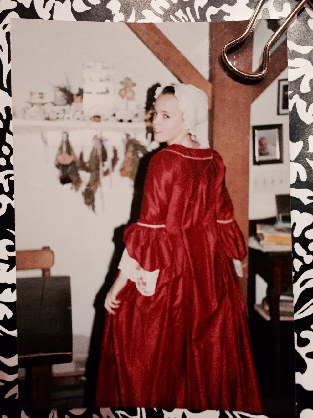 That's me, in my favorite CW dress, maybe around 1991. It is the only gown that was designed just for me. I wore it in a program at the governor's palace, and to a few other places as well.