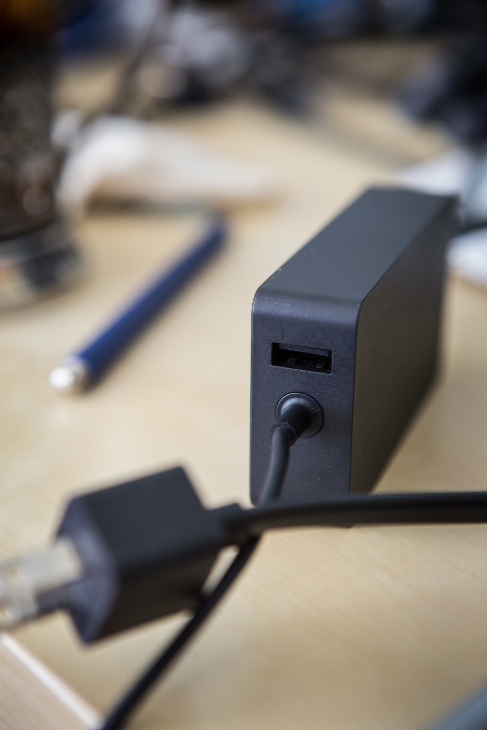 There is a USB port on the power cord to charge any device while powering the Surface.