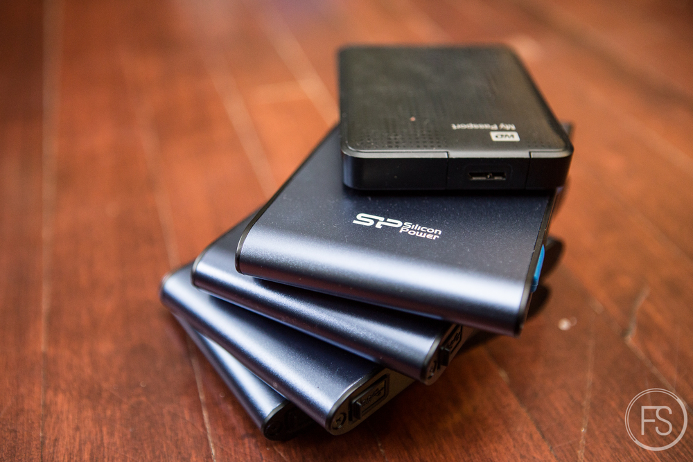 Silicon Power A80 1TB external hard drives. Those things are larger than a WD My Passport but they are military grade. Those things can resist water, drops, fire...crazy stuff. Click on the image for the review of my friend Ben Von Wong