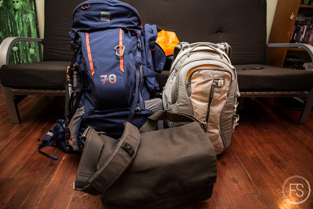 The main big backpack. The Kata Bumblebee-UL-222 which I own and love would be too big to carry along. The LoweproPro Messenger 200 AW (which I also own and love)does not fit well as a front carrying bag and is far from ideal for hiking.