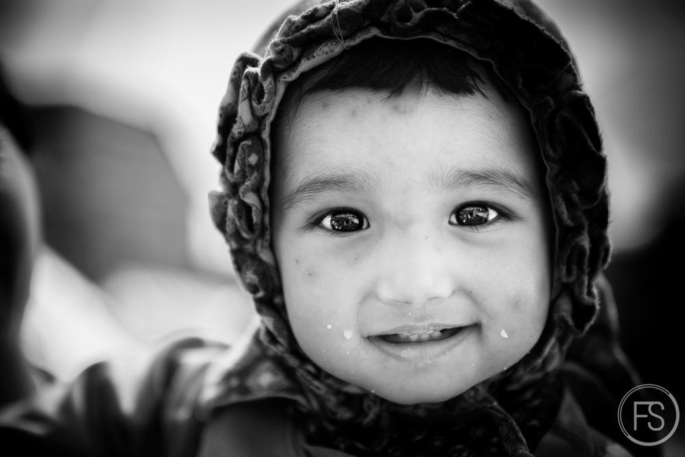 Le jeune enfant de la photo #11.