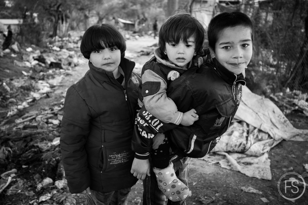 A brave young man carrying his brother in the desolation that is Moria camp in Lesvos.