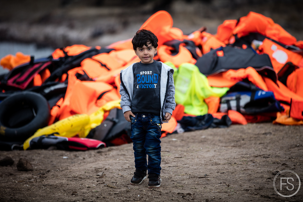 The shores of Lesvos getting littered with trash and life jackets.
