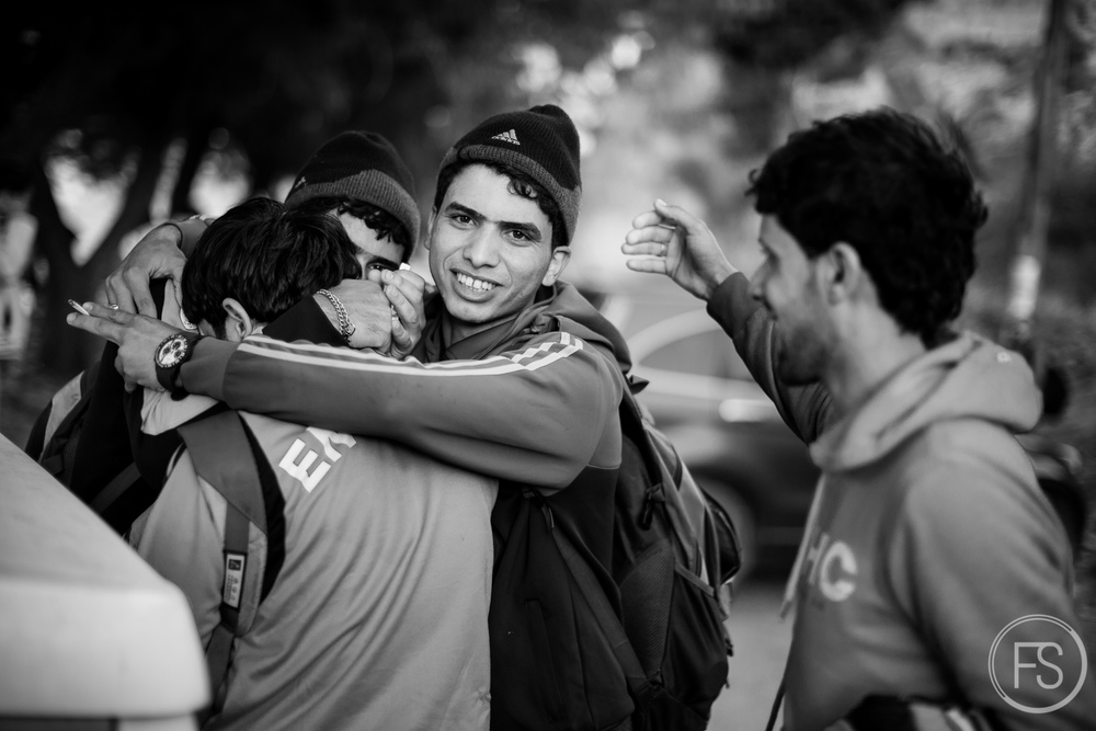 Friends hug and cheer after arriving safely in Lesvos near the beach of Skala Sikamineas. Most arrivals go well and are the occasion for celebrating the beginning of a new life and leaving the dangers of the past life behind. Volunteers (and photographers) are often included in these celebrations and expressions of gratitude.
