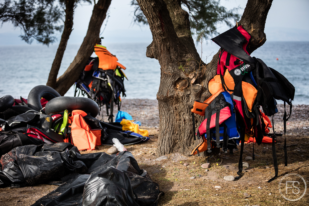 Dozens of life vests cover the shores of Skala Sikamineas on Lesvos island. A quick look is enough to see that most of them are fake and do not respect any security standards. They are not adequate to keep someone afloat long enough for rescue teams to arrive and can not be used again.