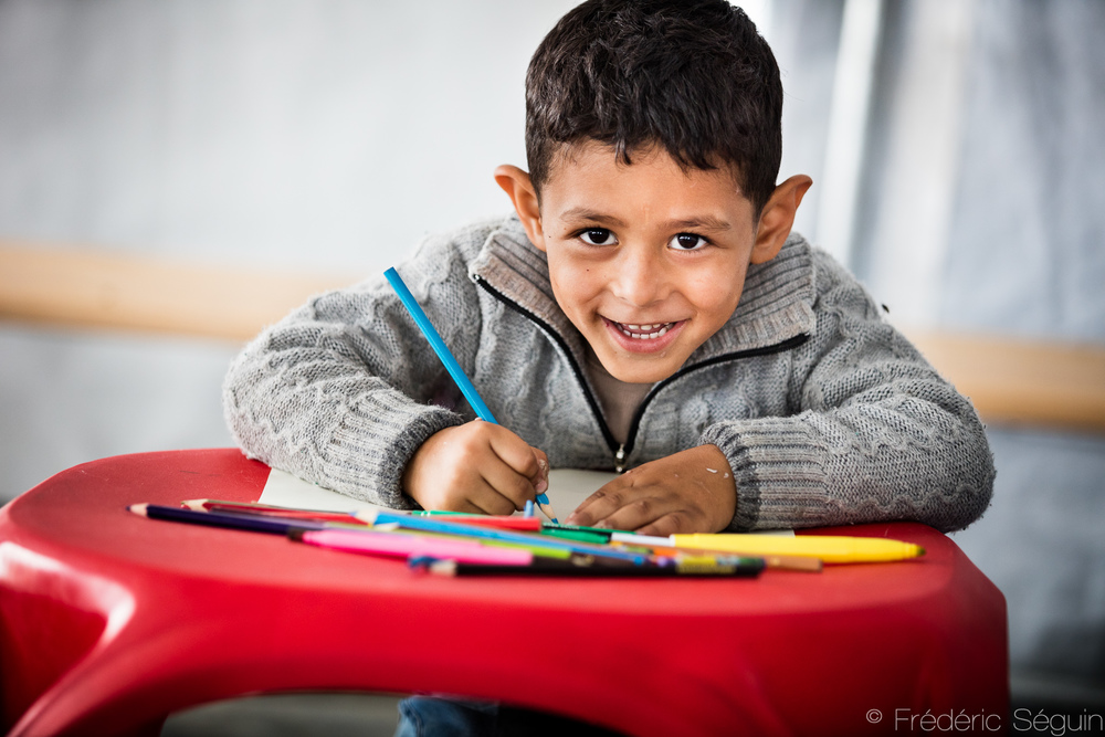 Young, I had only to ask my parents for a pencil when I lost one, never realizing how precious it was. With a smile like this, it's easy to see that this Syrian child knew perfectly how precious a pencil can be.  UNICEF tent in Geveglija, Macedonia (FYROM).
