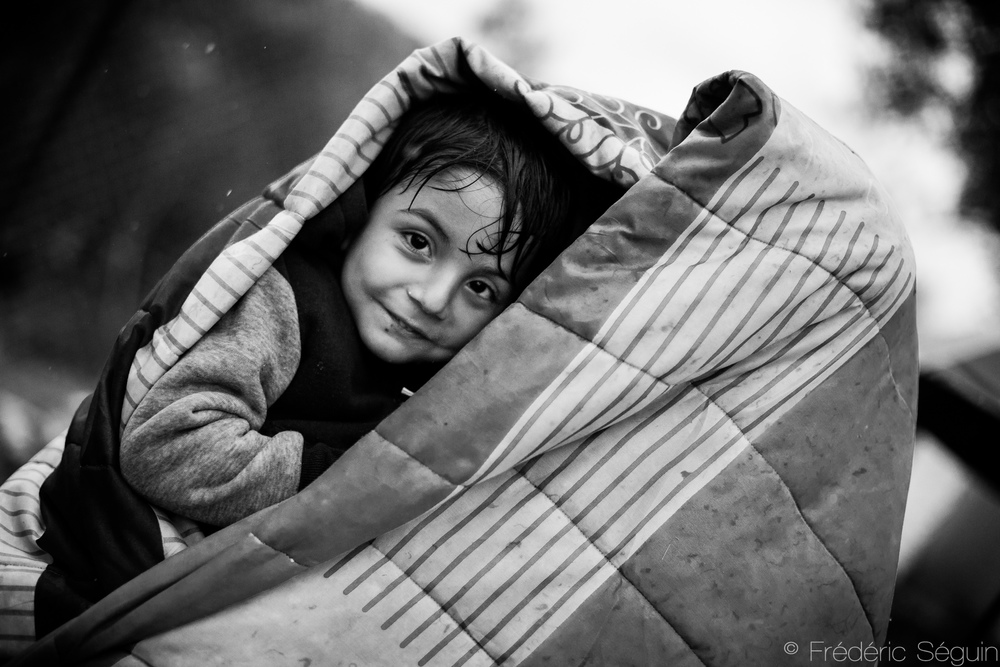 In the harshest conditions I met so far following the refugees, I thought no one could smile, especially not me. This boy had not given up on hope and his eyes were still shining and his smile radiating. There is always a way to smile, always. Moria, Lesvos, Greece.
