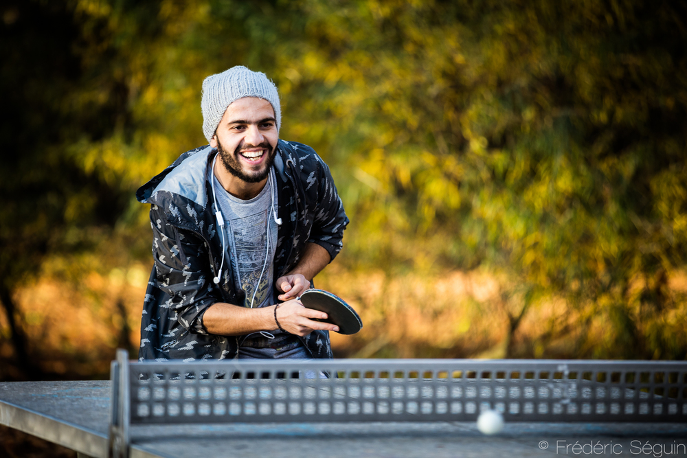 """""""I love to go around the park at this time of the day. There's always someone with whom to play ping-pong or basketball, local people or refugees. If I don't know anyone, I just introduce myself and start talking."""" -Salim, from Syria.Eberswalde, Germany."""