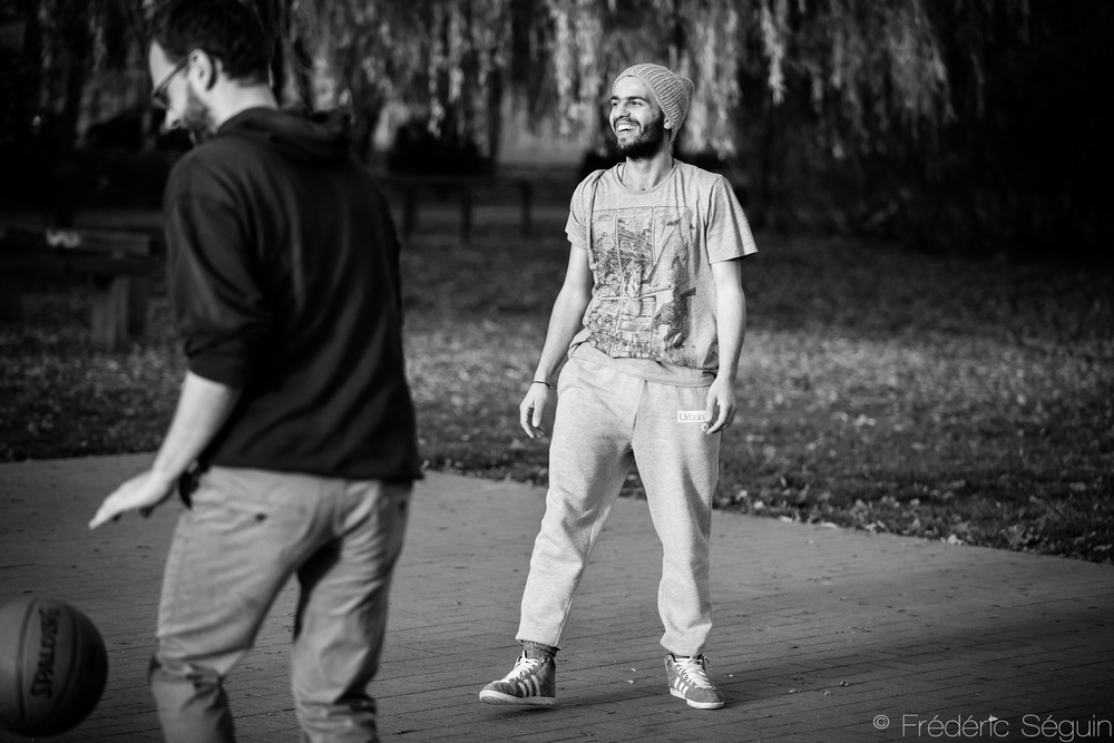 Salim playing basketball in the park with one fellow refugee and four local Germans. Sport is a universal language that anyone can speak.The integration of refugees in this little town is going splendidly.Eberswalde, Germany.
