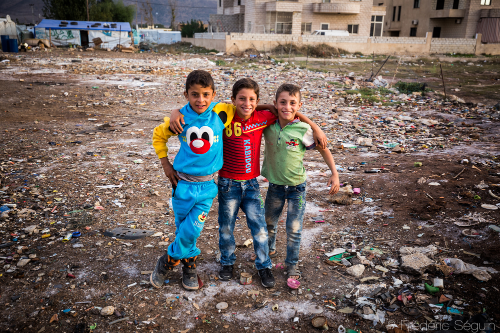 A group of young friends together in their playground that is the improvised refugee camp where they live. Bekaa Valley, Lebanon.