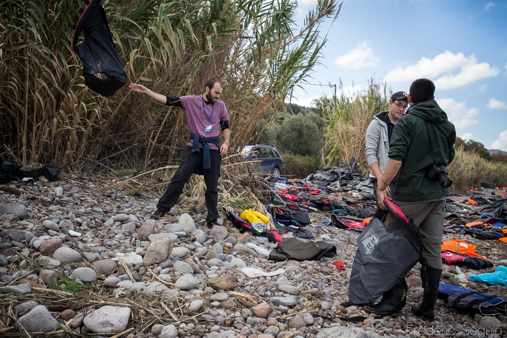 The team of Volunteers Coordination Lesvos is cleaning the shores of Skala Sikamineas from the mountains of life jackets that are dropped after refugees land on the island. Lesvos Island, Greece.