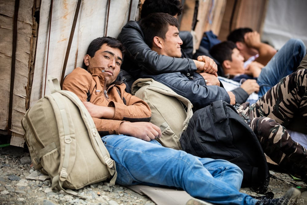 A group of men gets some rest while waiting for their train to get out of the camp. Getting some proper sleep and rest is one of the hardest part of the journey for the refugees. Gevgelija, Macedonia (FYROM).