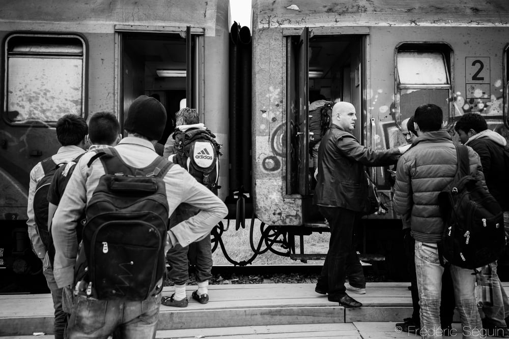 Refugees get inside the train that will take them from the South to the North of Macedonia (FYROM) where they will walk towards Serbia. This train usually costs around 5 euros for the locals but refugees are charged 25 euros in a train that will be overcrowded. Gevgelija, Macedonia (FYROM).