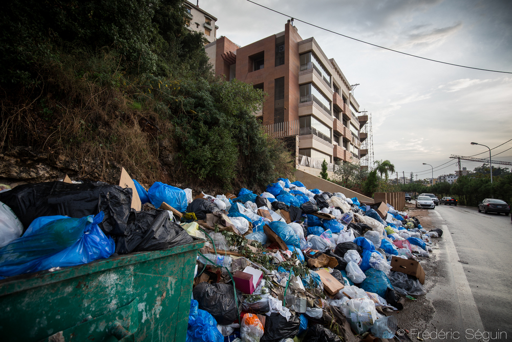 The sides of the streets are filled with garbage, at the feet of the upscale apartment buildings. The problem is present in all Beirut, from the poor areas to the richer neighborhoods like Baabda. Beirut, Lebanon. November 2015.