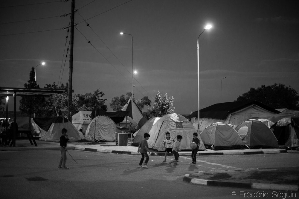 Kids always find ways to entertain themselves and make the best of the worst situations. They spend their days (and nights)playing around in the best cases but also lose time for their education. Eko Petrol station Camp, Polykastro area, Greece. May 2016.