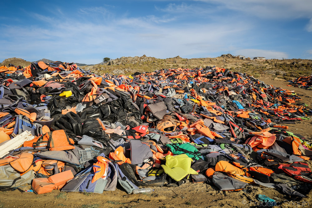 One life-jacket for every life that went through the perilous journey across the Aegean Sea. They are left on the island in an improvised landfill and there is no solution at the moment to recycle or get rid of them. Lesvos Island, Greece. June 2016.