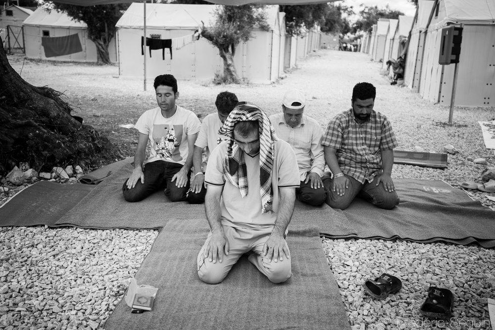 Ritual prayers during the first day of Ramadan. Lesvos Island, Greece. June 2016