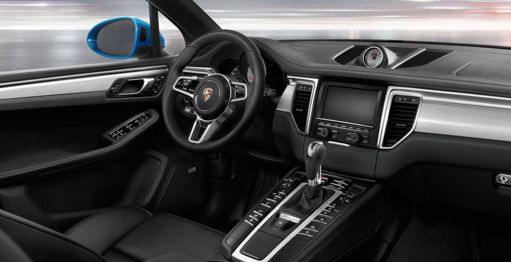 The 2015 Porsche Macan interior leaves much to be desired in terms of bringing the dashboard into the mobile era. Photo courtesy ( Porsche ).