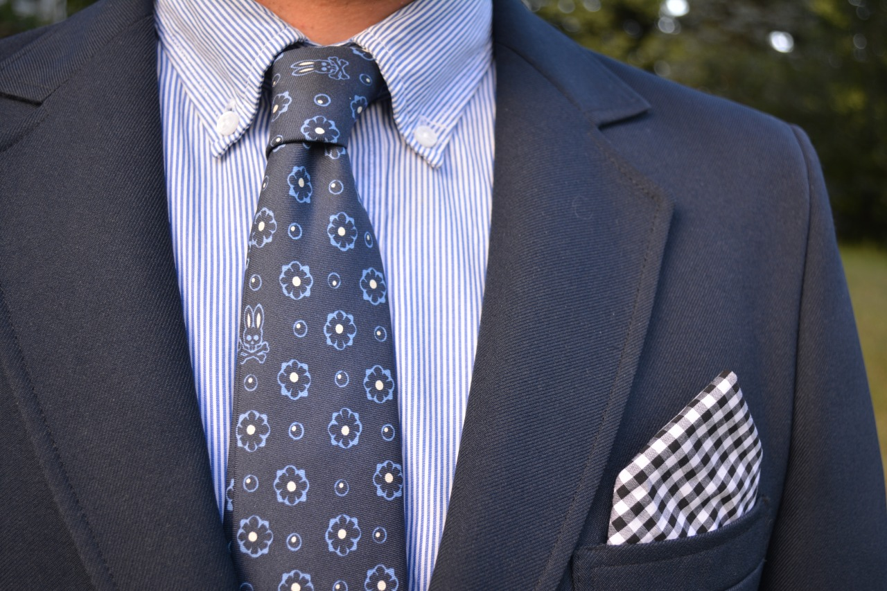 A foulard tie is essential for any fashionable mans wardrobe. This particular one by  Psycho Bunny  is my new favorite. Look closely and see their logo. Along with neckties,  they sell a variety of stylish mens clothing . My simple suggestions would be to make sure that the button down shirt is lighter than the tie and that the pocket square coordinates but doesn't match exactly. This creates visual interest.
