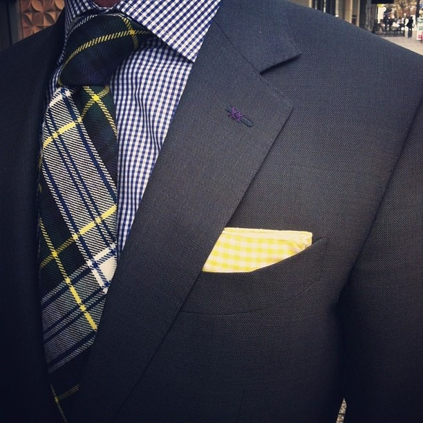 good use of a yellow pocket square.