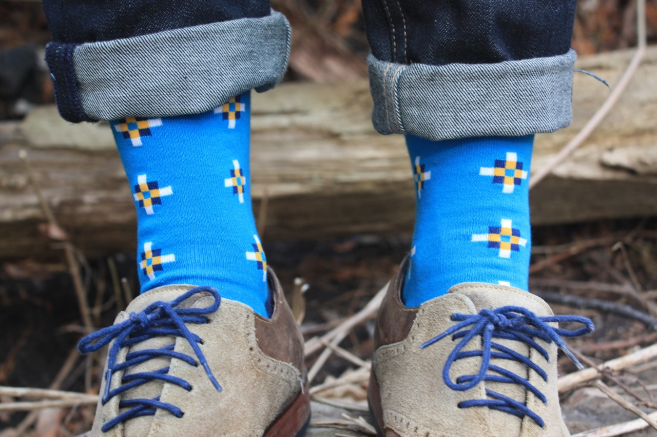 Invest in socks that pack a powerful punch. Statement socks are a simple and inexpensive way to upgrade any look. This blue pair i got from  Socking Behavior  and were made by  Richer Poorer .