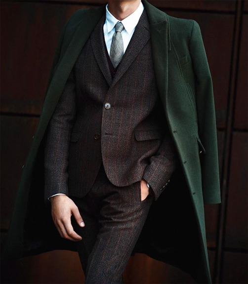 this is a really good look. not only is green one of my favorite colors in menswear this suit looks really good too. i love how high buttoned it is. looks a bit more modern and fresh to me. A+