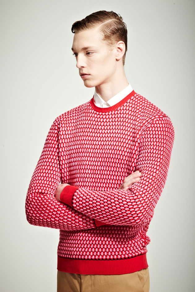 i would like this sweater in blue. i like how this is styled with a shirt buttoned to the very top.