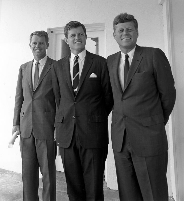 JFK forgot to unbutton the bottom button!