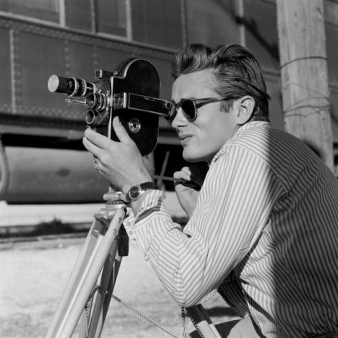 "nickdrake :     James Dean close up with a Bolex camera on the set of ""Giant"", 1955"