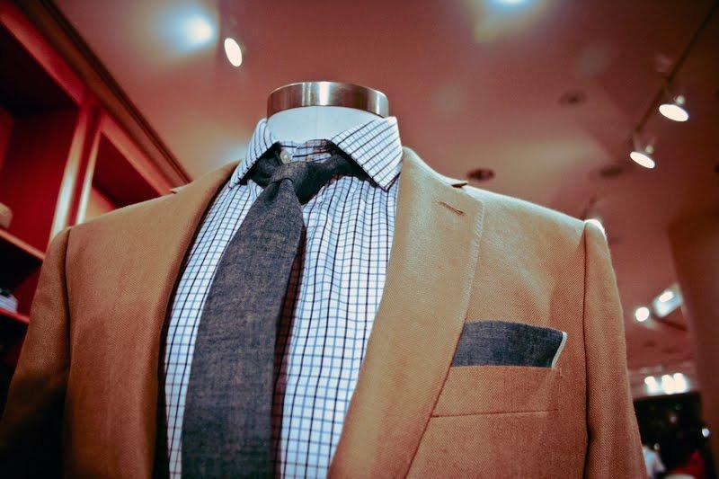 khaki suit.