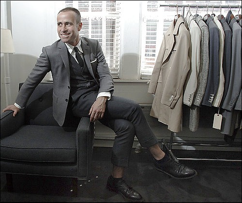 "todaystie :     ""I don't kid myself thinking everyone loves it,"" says designer Thom Browne of his signature slim-fitted silhouette""                                                Thom Browne."